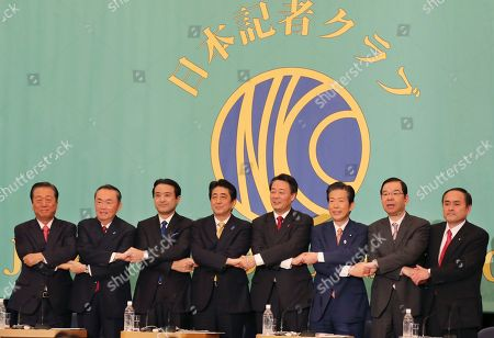 Ichiro Ozawa,Takeo Hiranuma,Kenji Eda,Shinzo Abe,Banri Kaieda,Natsuo Yamaguchi,Kazuo Shii,Tadatomo Yoshida Leaders of eight Japanese political parties join their hands together at the start of their debate for lower house election to be held on Dec. 14 at the Japan National Press Club in Tokyo, . Parties' leaders are from left, People's Life Party Ichiro Ozawa,The Party for Future Generations Takeo Hiranuma, Japan Innovation Party Kenji Eda, Liberal Democratic Party and Japan's Prime Minister Shinzo Abe, Democratic Party of Japan Banri Kaieda, the New Komeito party Natsuo Yamaguchi, Japanese Communist Party Kazuo Shii, and chair of the Social Democratic Party Tadatomo Yoshida