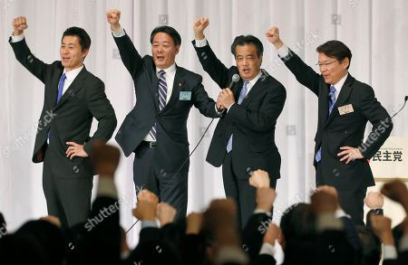 Stock Image of Katsuya Okada, Goshi Hosono, Banri Kaieda, Akira Nagatsuma Katsuya Okada, third from left, punches the air with other senior members of the Democratic Party of Japan after being elected a leader of the main opposition party, in Tokyo, . They are, from left, Goshi Hosono, Banri Kaieda, Okada and Akira Nagatsuma