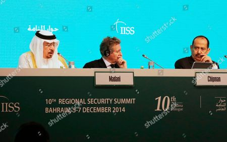"""Saudi Arabia's Minister of State for Foreign Affairs Dr Nizar Madani, left, speaks as Dr John Chipman Director-General and Chief Executive, IISS, center, and Yemen's Chief, National Security Bureau, Dr Ali Al Ahmadi, right, listen during the 10th International Institute for the Strategic Studies in Manama, Bahrain, . Britain's top diplomat says his nation has signed a deal with the Gulf Arab nation of Bahrain to bolster the United Kingdom's military presence in the region. Foreign Secretary Philip Hammond announced the deal Saturday at a security conference in the Bahraini capital, Manama, where he assured Gulf allies that """"your security concerns are our security concerns"""