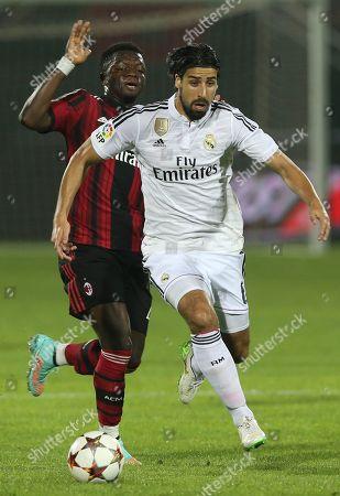 Sami Khedira, Sulley Ali Muntari Real Madrid's Sami Khedira controls the ball as AC Milan's Sulley Ali Muntari goes after him during Dubai Football Challenge match in Dubai, United Arab Emirates