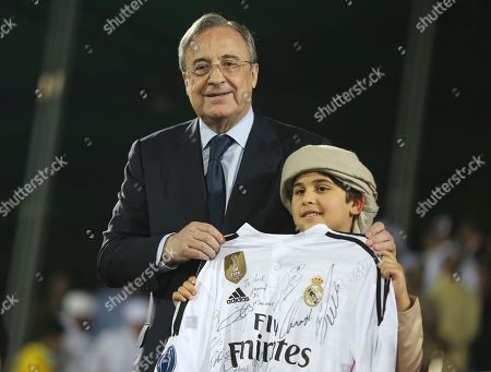 Florentino Perez, Sheikh Mohammed Bin Mansour bin Zayed Al-Nahyan Real Madrid football club's President Florentino Perez poses for a photo with Sheikh Mohammed Bin Mansour bin Zayed Al-Nahyan, the grandson of Prime Minister and Ruler of Dubai, Sheikh Mohammed bin Rashid Al-Maktoum during Dubai Football Challenge match in Dubai, United Arab Emirates