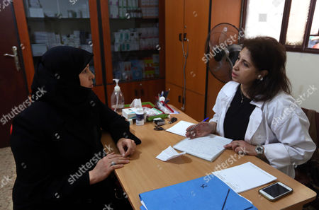 Hoda Barakat, right, a registered midwife, speaks with Syrian Wafaa Daaboul, 45, at a natal clinic in Beirut, Lebanon. Nearly 30,000 Syrian children born as refugees in Lebanon are in a legal limbo, not registered with any government, exposing them to the risk of a life of statelessness deprived of basic rights