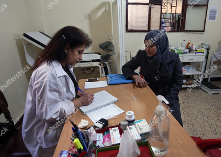 Hoda Barakat, left, a registered midwife, speaks with Syrian Manal al-Allan, 24, at a natal clinic in Beirut, Lebanon. The daily hardships of life as a refugee keep many Syrian parents from registering their newborns: no money, no documents, little time off from work. The process is complicated, with multiple steps that require travel from one government office to another, money for fees and, most importantly, a slew of documents. Without the parents' marriage license, for example, the birth of a child cannot be registered. But many Syrians had to flee their homeland on short notice and so left legal papers behind, or their papers were destroyed along with their homes
