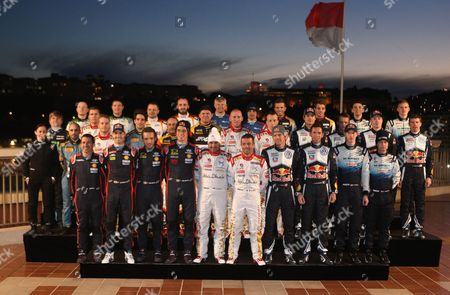 WRC drivers pose for the official photo before the start of the 83rd Rally of Monte Carlo, in Monaco. The Rally of Monte Carlo is the first event of the 2015 FIA World Rally Championship calendar. First row, left to right, co driver Marc Matti and Driver Dani Sordo of Spain, co driver Nicolas Gilsoul and driver Thierry Neuville of Belgium, co driver Daniel Elena of Monaco and driver Sebastien Loeb, 2014 World champion Sebastien Ogier of France and his co driver Julien Ingrassia of France, British driver Elfyn Evans and his co driver Daniel Barritt of Great Britain