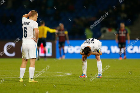 Auckland City FC's John Irving, left, and Auckland City FC's Ivan Vicelich react after missing a goal during the semi final soccer match between Auckland City FC and San Lorenzo at the Club World Cup soccer tournament in Marrakech, Morocco