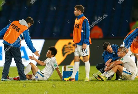 Auckland City FC's Takuya Iwata, second left, CAmeron Lindsay, center, and John Irving react after losing in the semi final soccer match between Auckland City FC and San Lorenzo at the Club World Cup soccer tournament in Marrakech, Morocco, . San Lorenzo won 2-1