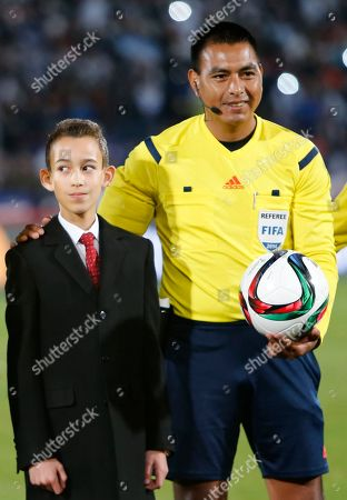 Moroccan Crown Prince Moulay El Hassan, left, and referee Walter Lopez, of Guatemala, pose before the final match for Club World Cup soccer tournament opposing Real Madrid to San Lorenzo, in Marrakech, Morocco