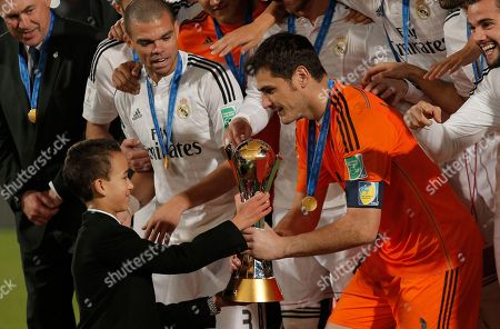 Iker Casillas, Prince Moulay El Hassan Real Madrid's Iker Casillas receives the trophy from Moroccan Crown Prince Moulay El Hassan after winning the final soccer match between Real Madrid and San Lorenzo at the Club World Cup soccer tournament in Marrakech, Morocco
