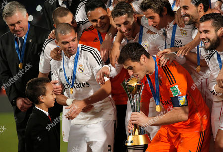 Iker Casillas, Prince Moulay El Hassan Real Madrid's Iker Casillas kisses trophy he received from Moroccan Crown Prince Moulay El Hassan after winning the final soccer match between Real Madrid and San Lorenzo at the Club World Cup soccer tournament in Marrakech, Morocco