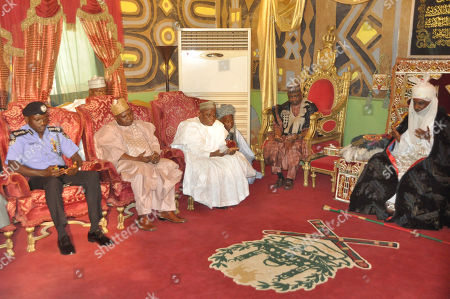 Emir of Kano, Lamido Sanusi, right, Nigeria Vice President, Namadi Sambo, second right, visit the Emir following last Friday explosion in a mosque, in Kano, Nigeria, . More than one hundred people were killed in the bomb explosions at the central mosque in the city of Kano on Friday, said a hospital worker