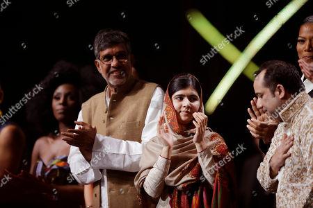 Joint-Nobel Peace Prize winners Malala Yousafzai, center, and Kailash Satyarthi, left, of India applaud on stage with Pakistani musician Rahat Fateh Ali Khan, right, at the end of the Nobel Peace Prize Concert in Oslo, Norway, . Malala Yousafzai from Pakistan and Kailash Satyarthi of India received the Nobel Peace Prize on Wednesday for risking their lives to help protect children from slavery, extremism and forced labor at great risk to their own lives