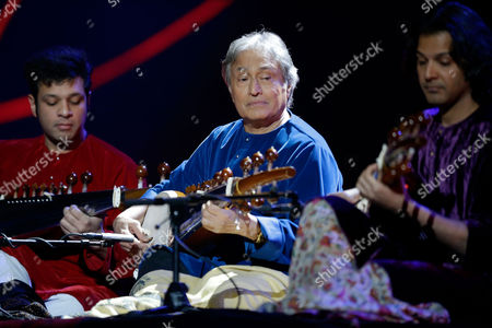 Stock Picture of Indian musician Amjad Ali Khan, center, performs on stage during the Nobel Peace Prize Concert in Oslo, Norway, . Malala Yousafzai from Pakistan and Kailash Satyarthi of India received the Nobel Peace Prize on Wednesday for risking their lives to help protect children from slavery, extremism and forced labor at great risk to their own lives