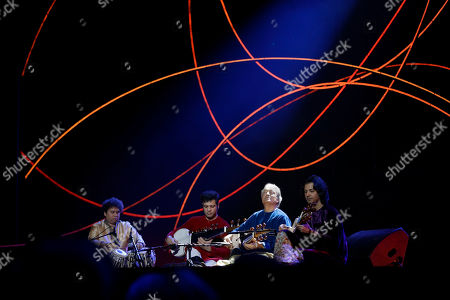 Indian musician Amjad Ali Khan, second right, performs on stage during the Nobel Peace Prize Concert in Oslo, Norway, . Malala Yousafzai from Pakistan and Kailash Satyarthi of India received the Nobel Peace Prize on Wednesday for risking their lives to help protect children from slavery, extremism and forced labor at great risk to their own lives