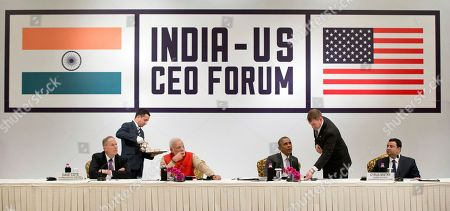 Barack Obama, Narendra Modi, Dave Cote Seated from left, Dave Cote, CEO, Honeywell, Indian Prime Minister Narendra Modi, U.S President Barack Obama, and Cyrus Mistry, Chairman, Tata Group, are served tea as they participate in a CEO roundtable discussion at the The Taj Mahal Hotel in New Delhi, India