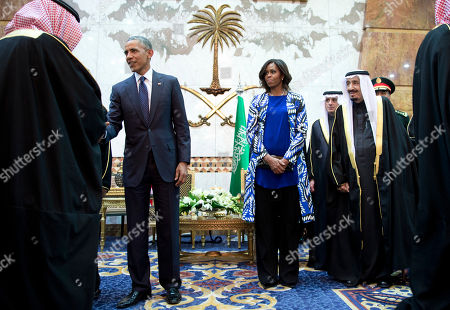 Barack Obama, Salman bin Abdul Aziz, Michelle Obama President Barack Obama and first lady Michelle Obama participate in a delegation receiving line with new Saudi Arabian King, Salman bin Abdul Aziz, fith left, in Riyadh, Saudi Arabia, . The president and first lady have come to expresses their condolences on the death of the late Saudi Arabian King Abdullah bin Abdulaziz al-Saud