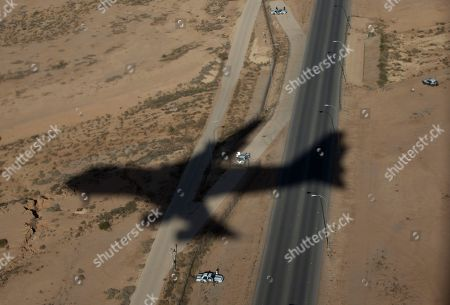 Barack Obama, Michelle Obama The shadow of Air Force One with President Barack Obama and first lady Michelle Obama, aboard is seen on approach to King Khalid International Airport, in Riyadh, Saudi Arabia, . The president will meet with the new Saudi King, Salman bin Abdul Aziz to expresses his condolences on the death of the late Saudi Arabian King Abdullah bin Abdulaziz al-Saud