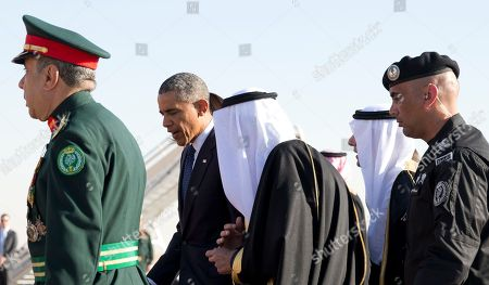Barack Obama, Michelle Obama President Barack Obama walks with new Saudi King, Salman bin Abdul Aziz, as he and first lady Michelle Obama arrive on Air Force One at King Khalid International Airport, in Riyadh, Saudi Arabia, . The president and the first lady have come to expresses his condolences on the death of the late Saudi Arabian King Abdullah bin Abdulaziz al-Saud
