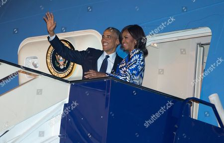 Barack Obama, Michelle Obama President Barack Obama and first lady Michelle Obama board Air Force One at King Khalid International Airport, in Riyadh, Saudi Arabia, after meeting with the new Saudi King, Salman bin Abdul Aziz to expresses condolences on the death of the late Saudi Arabian King Abdullah bin Abdulaziz al-Saud. The president and first lady are en route to Washington by way of Ramstein Air Base, Germany