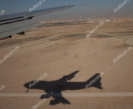 Barack Obama, Michelle Obama The shadow of Air Force One with President Barack Obama and first lady Michelle Obama aboard is seenwhile landing at King Khalid International Airport, in Riyadh, Saudi Arabia, . The president will meet with the new Saudi King, Salman bin Abdul Aziz to expresses his condolences on the death of the late Saudi Arabian King Abdullah bin Abdulaziz al-Saud