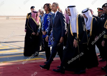 Stock Picture of Barack Obama, Michelle Obama President Barack Obama and first lady Michelle Obama walks with new Saudi King, Salman bin Abdul Aziz as they arrive on Air Force One at King Khalid International Airport, in Riyadh, Saudi Arabia, . The president and the first lady have come to expresses his condolences on the death of the late Saudi Arabian King Abdullah bin Abdulaziz al-Saud