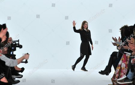 Stock Photo of Fashion designer Ece Ege waves after the presentation of Dice Kayek's Spring-Summer 2015 Haute Couture fashion collection in Paris, France