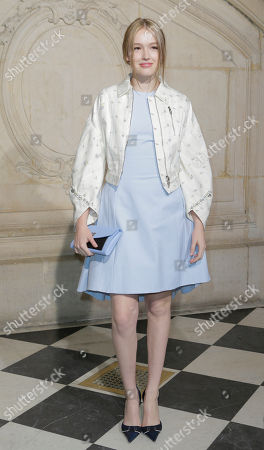 Maddison Brown poses before Dior's Haute Couture spring-summer 2015 fashion show in Paris, France