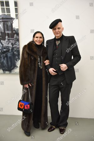 """Lebanese business woman Mouna Ayoub, left, and Artist Ali Mahdavi attend Elie Top's first """"Joaillerie Haute Fantaisie"""" collection, in Paris, France"""