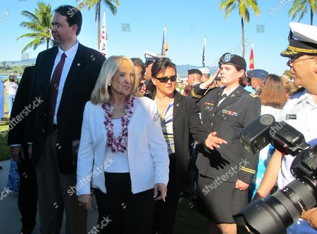 Jan Brewer Arizona Gov. Jan Brewer, center, is surrounded by unidentified officials as she attends the 73rd anniversary ceremony of the attack on Pearl Harbor, in Hawaii on . Gov. Brewer toured the memorial of the sunken battleship USS Arizona and then make a visit to a modern warship named for an Arizona city, the attack submarine USS Tucson