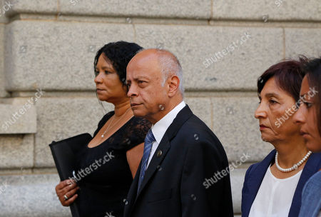 Prakash Dewani, center, the father of British businessman Shrien Dewani, arrives at the high court in the city of in Cape Town, South Africa, . A British man Shrien Dwani accused of killing his wife Anni while they were on honeymoon in Cape Town was acquitted of murder on Monday after a South African judge concluded that the prosecution's case did not have sufficient evidence. Shrien Dewani promptly descended stairs leading out of the courtroom following the not guilty ruling by Cape Town High Court Judge Jeanette Traverso
