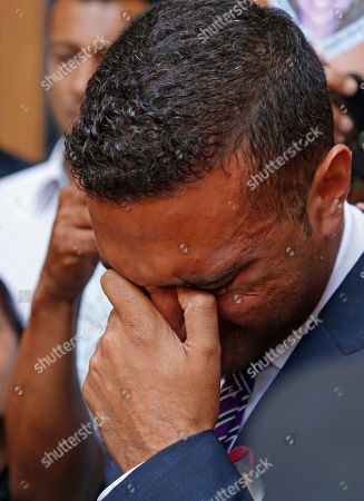 Anish Hindocha, puts his hand to his face after the court case that acquitted his sister's former husband Shrien Dwani from murdering her at the high court in Cape Town, South Africa, . British man Shrien Dwani accused of killing his wife Anni while they were on honeymoon in Cape Town was acquitted of murder on Monday after a South African judge concluded that the prosecution's case did not have sufficient evidence. Shrien Dewani promptly descended stairs leading out of the courtroom following the not guilty ruling by Cape Town High Court Judge Jeanette Traverso
