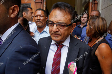Vinod Hindocha, center, the father of slain Anni Dewani, after the court case that acquitted his daughter's former husband Shrien Dwani from murdering her at the high court in Cape Town, South Africa, . British man Shrien Dwani accused of killing his wife Anni while they were on honeymoon in Cape Town was acquitted of murder on Monday after a South African judge concluded that the prosecution's case did not have sufficient evidence. Shrien Dewani promptly descended stairs leading out of the courtroom following the not guilty ruling by Cape Town High Court Judge Jeanette Traverso