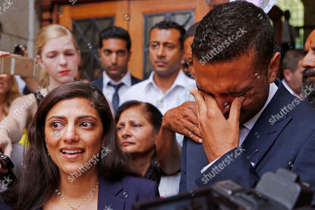 Ami Denborg, left, and her brother Anish Hindocha, right, react after the court case that acquitted their sister's former husband Shrien Dwani from murdering her at the high court in Cape Town, South Africa, . British man Shrien Dwani accused of killing his wife Anni while they were on honeymoon in Cape Town was acquitted of murder on Monday after a South African judge concluded that the prosecution's case did not have sufficient evidence. Shrien Dewani promptly descended stairs leading out of the courtroom following the not guilty ruling by Cape Town High Court Judge Jeanette Traverso