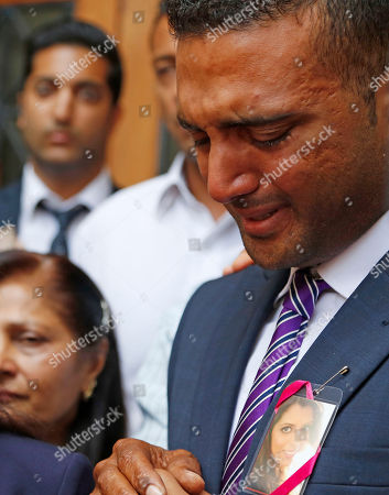 Anish Hindocha, reacts after the court case that acquitted his sister's former husband Shrien Dwani from murdering her at the high court in Cape Town, South Africa, . British man Shrien Dwani accused of killing his wife Anni while they were on honeymoon in Cape Town was acquitted of murder on Monday after a South African judge concluded that the prosecution's case did not have sufficient evidence. Shrien Dewani promptly descended stairs leading out of the courtroom following the not guilty ruling by Cape Town High Court Judge Jeanette Traverso