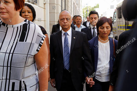 Prakash Dewani, center, the father of British businessman Shrien Dewani, arrives at the high court in the city of in Cape Town, South Africa, . British man Shrien Dwani accused of killing his wife Anni while they were on honeymoon in Cape Town was acquitted of murder on Monday after a South African judge concluded that the prosecution's case did not have sufficient evidence. Shrien Dewani promptly descended stairs leading out of the courtroom following the not guilty ruling by Cape Town High Court Judge Jeanette Traverso