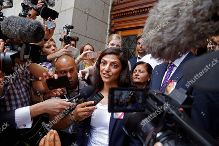 Ami Denborg, left, speak to media after the court case that acquitted her sister's former husband Shrien Dwani from murdering her at the high court in Cape Town, South Africa, . British man Shrien Dwani accused of killing his wife Anni while they were on honeymoon in Cape Town was acquitted of murder on Monday after a South African judge concluded that the prosecution's case did not have sufficient evidence. Shrien Dewani promptly descended stairs leading out of the courtroom following the not guilty ruling by Cape Town High Court Judge Jeanette Traverso