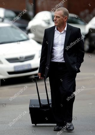 Gerrie Nel South Africa's State Prosecutor Gerrie Nel arrives at the high court in Pretoria, South Africa, . High Court Judge Thokozile Masipa is expected to rule on whether prosecutors can appeal against what they call the light sentence passed on Oscar Pistorius. The Paralympian athlete was jailed for five years in October for the culpable homicide of his girlfriend Reeva Steenkamp, whom he killed last year