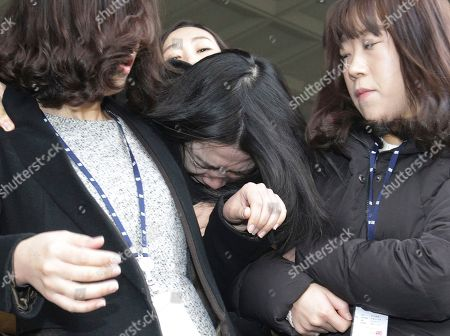 "Cho Hyun ah Cho Hyun-ah, center, former vice president of Korean Air Lines, is escorted by court officials as she leaves for Seoul Western District Prosecutors Office at the Seoul Western District Court Office in Seoul, South Korea. South Korean prosecutors on Wednesday charged the former Korean Air Lines executive who achieved worldwide notoriety by kicking a crew member off a flight with violating aviation security law and hindering a government investigation. Cho's actions amounted to ""threatening the safety of the flight and causing confusion in law and order,"" prosecutor Kim Chang-hee said during a briefing that was broadcast live by local television networks"