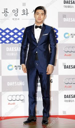 Choi Si-won South Korean actor and member of K-pop boy group Super Junior Choi Si-won poses for the media during a red carpet event for Blue Dragon Film Awards in Seoul, South Korea
