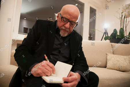 Paulo Coelho Brazilian author Paulo Coelho writes, during an interview with The Associate Press, at his apartment, in Geneva, Switzerland, . Coelho says the Sony hack threatens us all if society doesn't enforce important values against anonymous terrorists. The best-selling author says he was prepared to make himself an example - even if it meant inviting criticism and threats - if Sony Pictures had taken him up on his $100,000 offer for the rights to its cancelled film