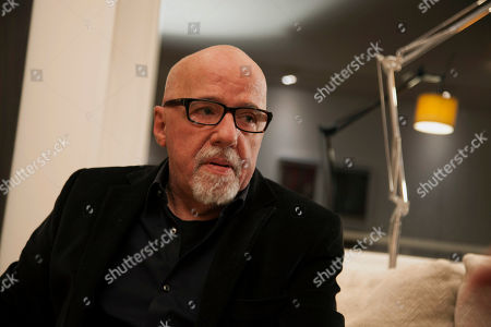 Paulo Coelho Brazilian author Paulo Coelho pauses during an interview with The Associate Press, at his apartment, in Geneva, Switzerland, . Coelho says the Sony hack threatens us all if society doesn't enforce important values against anonymous terrorists. The best-selling author says he was prepared to make himself an example - even if it meant inviting criticism and threats - if Sony Pictures had taken him up on his $100,000 offer for the rights to its cancelled film