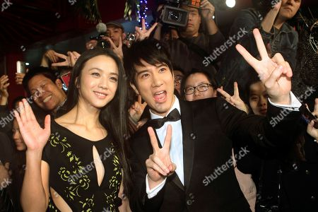 """Tang Wei, Wang Leehom Hong Kong actress Tang Wei, left, and Taiwanese actor Wang Leehom pose for a photo with fans during an event to promote their latest movie """"Blackhat"""" in Taipei, Taiwan"""