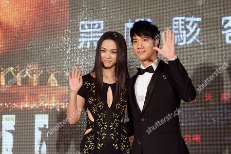 """Tang Wei, Wang Leehom Hong Kong actress Tang Wei and Taiwanese actor Wang Leehom pose for photographers during an event to promote their latest movie """"Blackhat"""" in Taipei, Taiwan"""