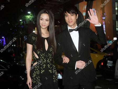 """Tang Wei, Wang Leehom Hong Kong actress Tang Wei, left, and Taiwanese actor Wang Leehom pose for photographers during an event to promote their latest movie """"Blackhat"""" in Taipei, Taiwan"""