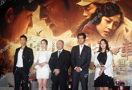 """Huang Xiaoming, Song Hye-kyo, John Woo, Takeshi Kaneshiro, Angeles Woo From left, Chinese actor Huang Xiaoming, South Korea actress Song Hye-kyo, Hong Kong director John Woo, Taiwan-born Japanese actor Takeshi Kaneshiro, and Hong Kong actress Angeles Woo pose for media during an event to promote their new movie """"The Crossing"""" in Taipei, Taiwan"""