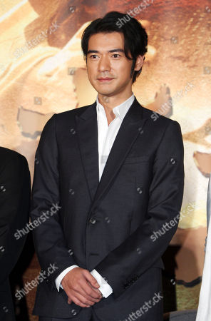 """Takeshi Kaneshiro Taiwan-born Japanese actor Takeshi Kaneshiro poses for media during an event to promote his new movie """"The Crossing"""" in Taipei, Taiwan"""