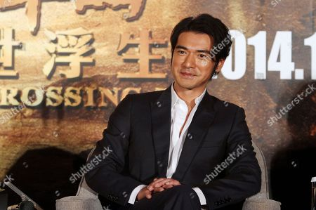 "Takeshi Kaneshiro Taiwan-born Japanese actor Takeshi Kaneshiro smiles during an event to promote his new movie ""The Crossing"" in Taipei, Taiwan"