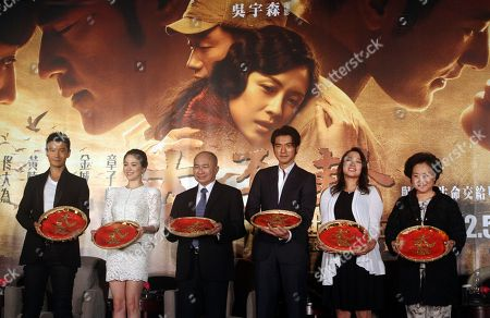 """Huang Xiaoming, Song Hye-gyo, John Woo, Takeshi Kaneshiro, Angeles Woo, Annie Woo From left, Chinese actor Huang Xiaoming, South Korea actress Song Hye-kyo, Hong Kong director John Woo, Taiwan-born Japanese actor Takeshi Kaneshiro, Hong Kong actress Angeles Woo, and Woo's wife Annie Woo pose for media during an event to promote their new movie """"The Crossing"""" in Taipei, Taiwan"""
