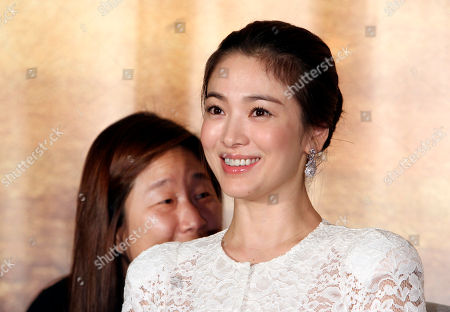 """Song Hye-kyo South Korea actress Song Hye-kyo smiles during an event to promote her new movie """"The Crossing"""" in Taipei, Taiwan"""