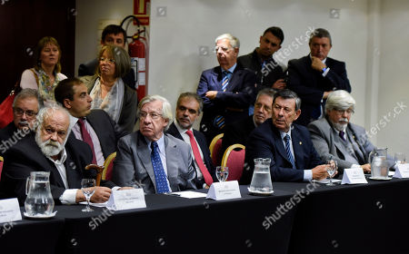 From left, front, Defense Minister, Eluterio Fernandez, future Economy Minister, Danilo Astori, future Foreigns Affairs Minister Rodolfo Nin and Interior Minister Luis Bonomi, listen in during a press conference by Uruguayan President-elect Tabare Vazquez where he announced his cabinet picks for his next term in Montevideo, Uruguay