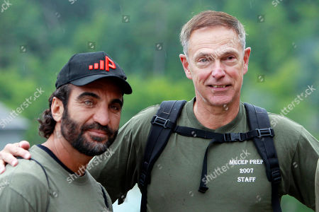 Afghan native Fahim Fazli, left, and retired Marine Michael Moffett pose for a photo at the base of Mount Washington, N.H. before ascending the mountain via the Ammonoosuc Ravine Trail. The two are co-authors of a book about Fazli's life as an Afghan native who fled his country, became a U.S. Citizen, a Hollywood actor who played roles as a Middle eastern terrorist, and returned to Afghanistan to be a translator for U.S. Marines. The two hiked Mount Washington in hopes the Presidential Range would be a stand in for a movie for Asia's Hindu Kush mountains